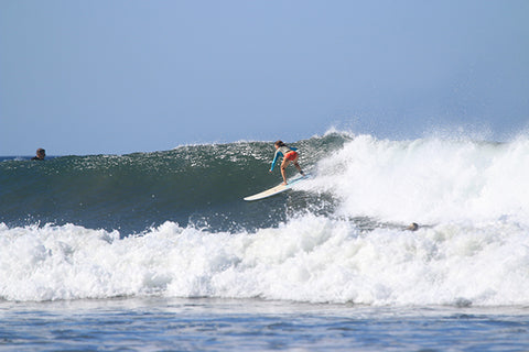 Sarah surfing from the front side bomb