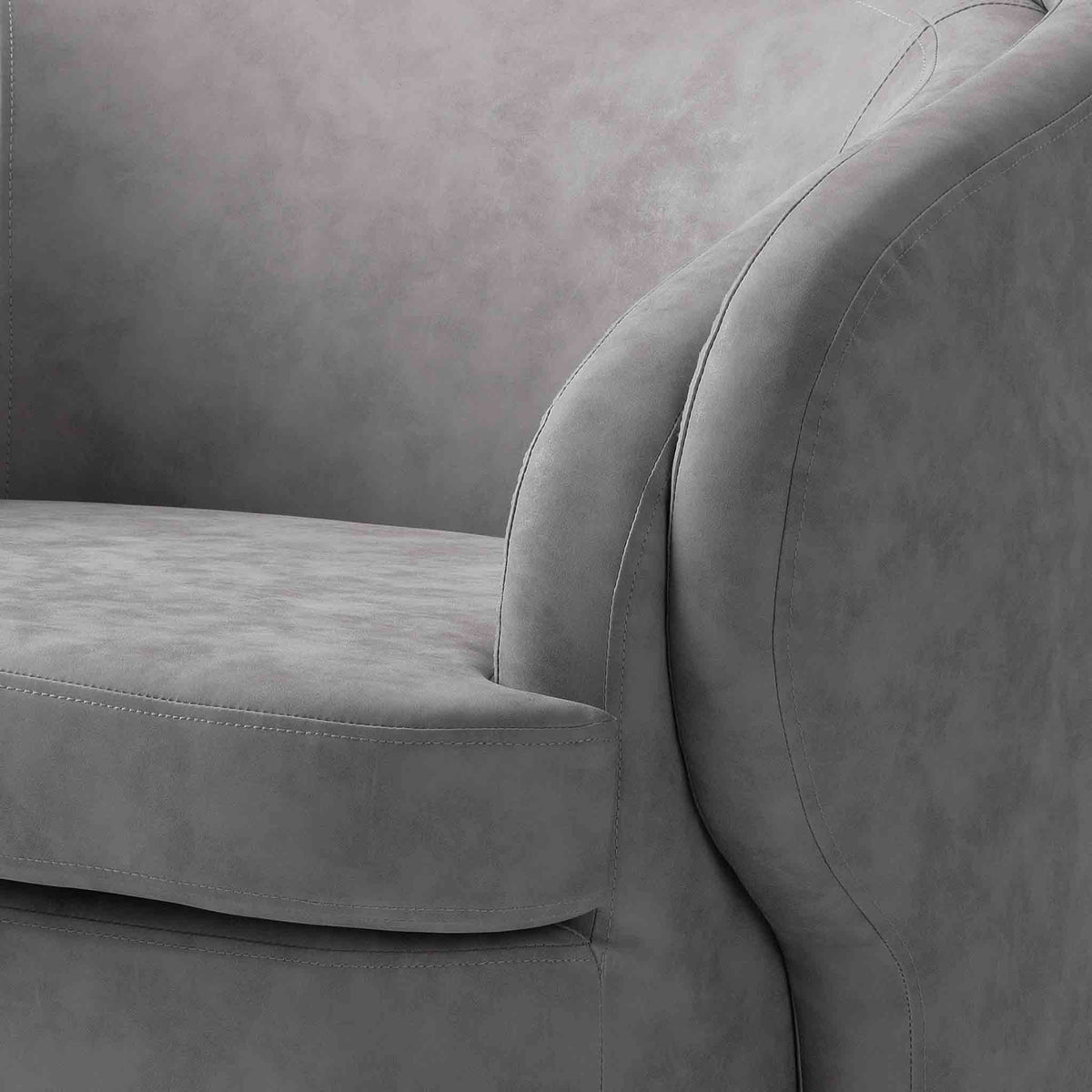 close up of curved armrest on the Bentley Grey Faux Leather Accent Chair