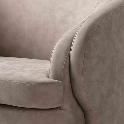 close up of the curved armrest on the Bentley Pewter Faux Leather Accent Chair