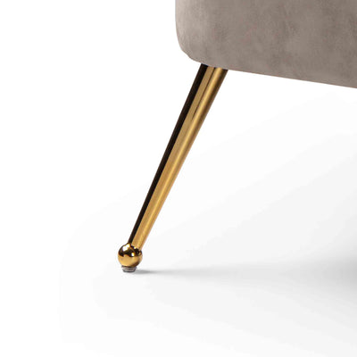 close up of the gold legs on the Bentley Pewter Faux Leather Accent Chair