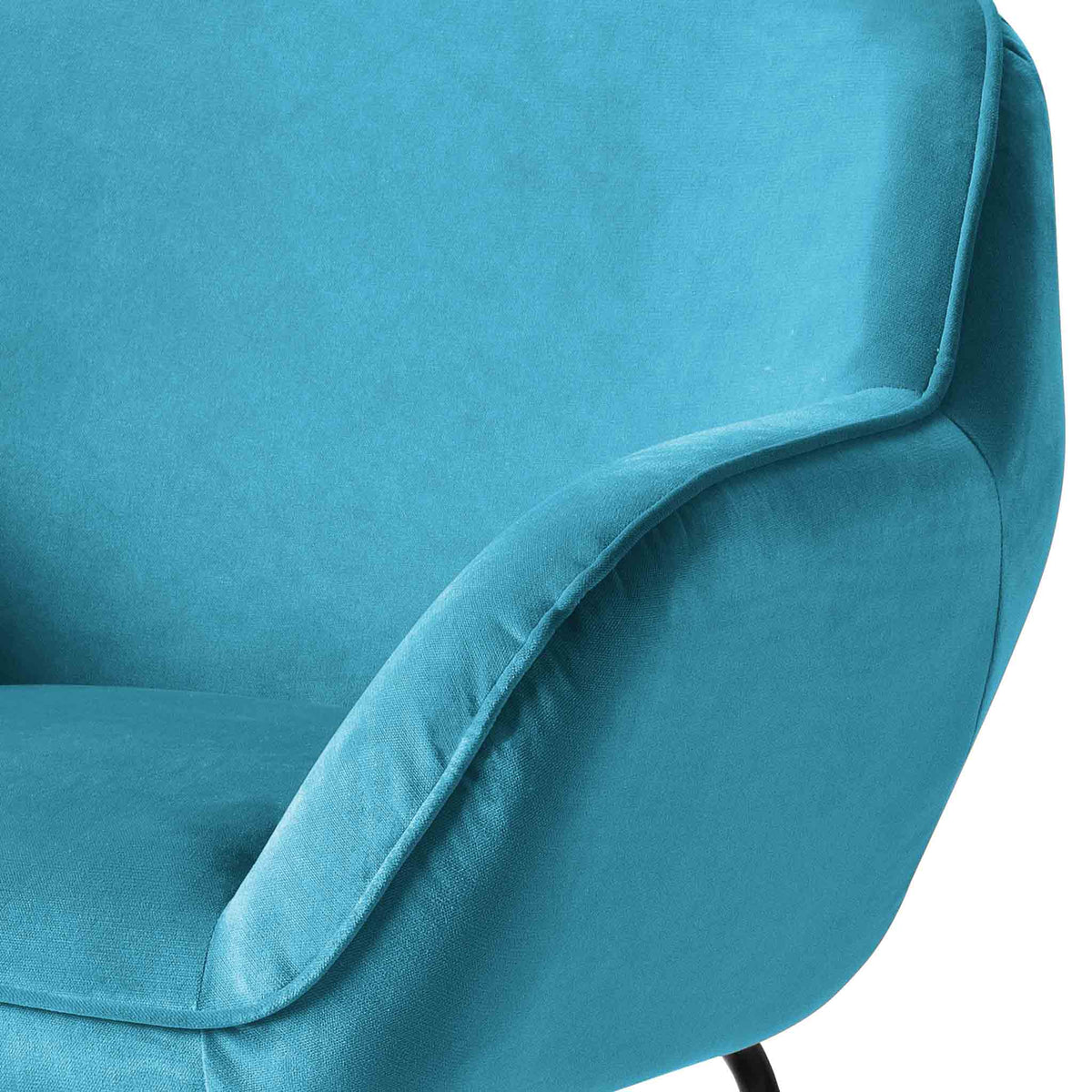 close up of the padded armrest on the Candy Lagoon Velvet Accent Chair