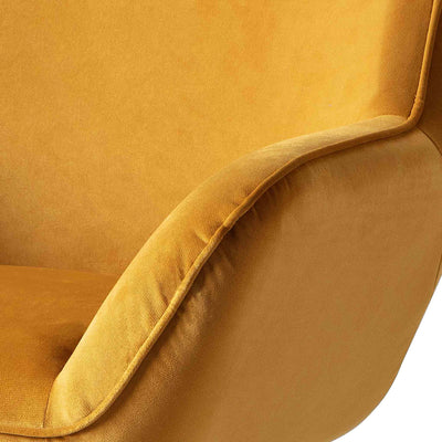 close up of the padded armrest on the Candy Gold Velvet Accent Chair