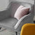 Candy Grey Velvet Accent Chair lifestyle image with pink cushion