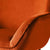 close up of padded armrests on the Candy Apricot Velvet Accent Chair