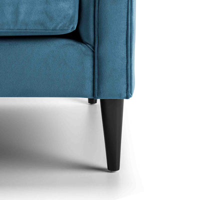 close up of the mid century solid wood tapered legs on the Savoy Peacock Velvet 2 Seater Accent Chair