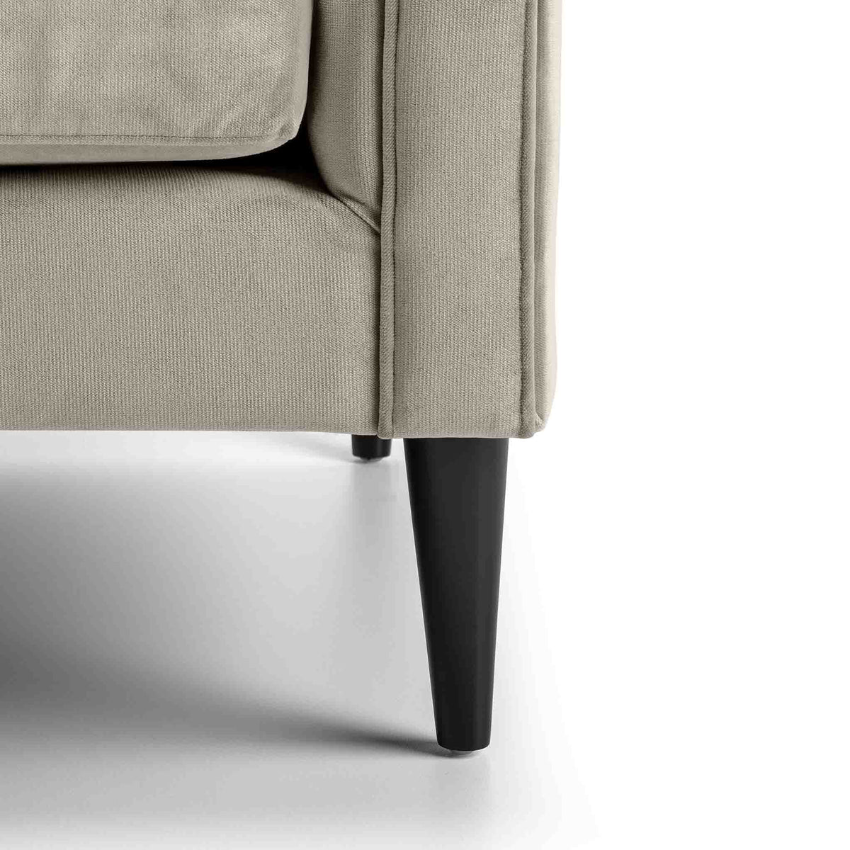 close up of the mid century solid wood tapered legs on the Savoy Putty Velvet 2 Seater Accent