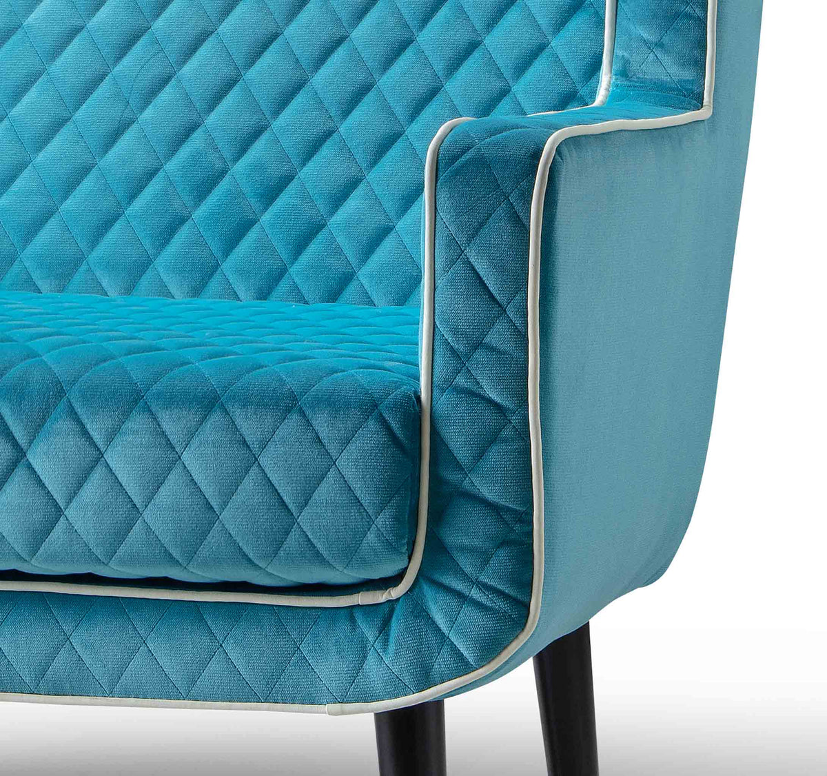 close up of upholstered velvet fabric on the Monty Lagoon Two Seater Chair