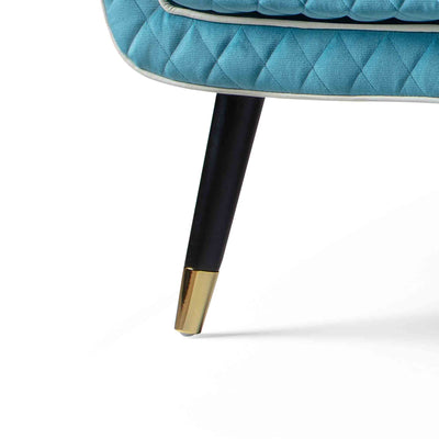 close up of the black legs with gold tipped feet on the Monty Lagoon Two Seater Chair