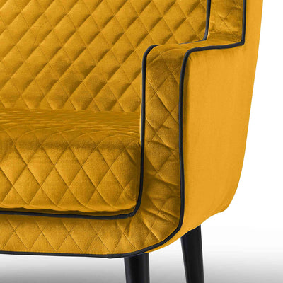 close up of the upholstered velvet fabric on the Monty Gold Two Seater Chair
