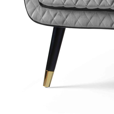 close up of the black legs with gold tipped feet on the Monty Grey Two Seater Chair
