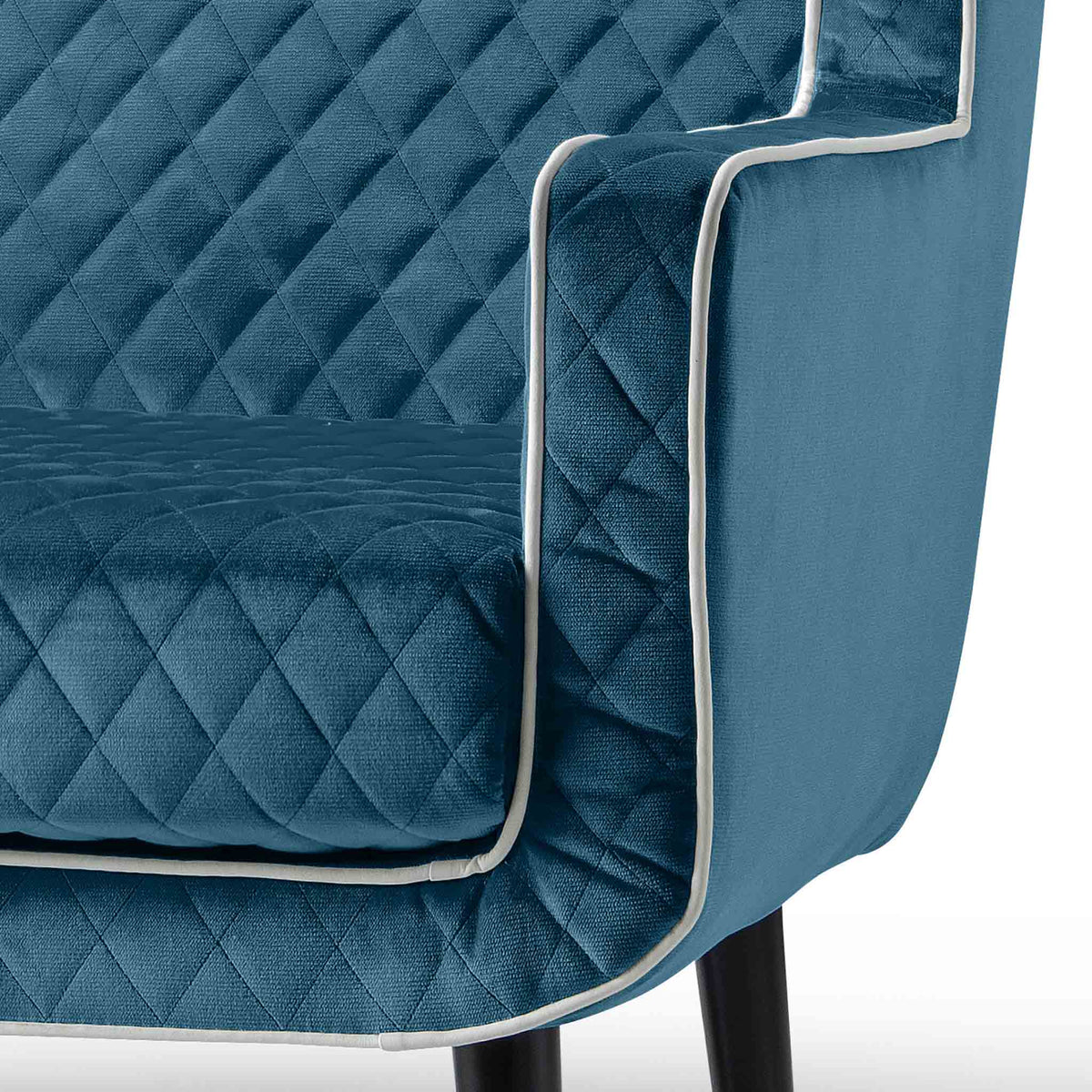 close up of the upholstered velvet fabric on the Monty Peacock Two Seater Chair
