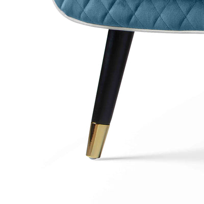 close up of the black legs with gold tipped feet on the Monty Peacock Two Seater Chair