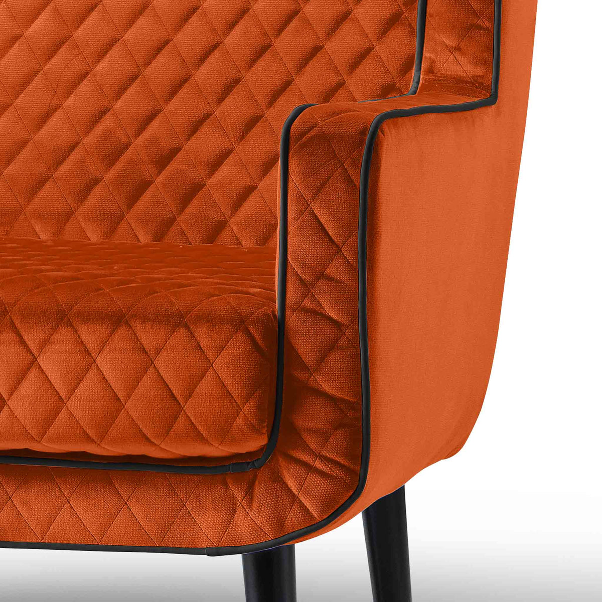 close up of the upholstered velvet fabric on the Monty Apricot Two Seater Chair