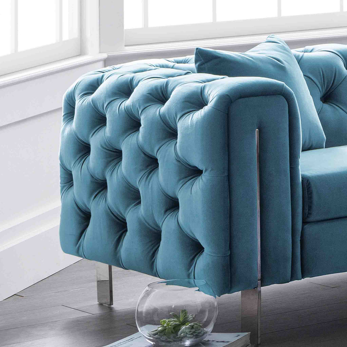 close up of the button tuft detail on the Ritz Peacock Velvet 2 Seater Chesterfield Sofa