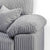 comfy cushioned armrests on the Amalfi Silver 2 Seater Fabric Sofa