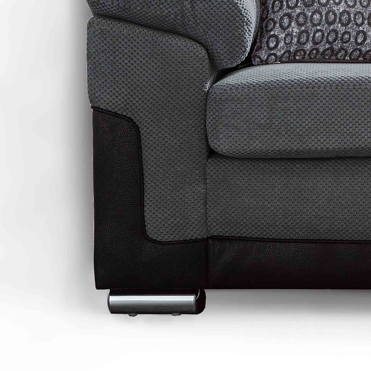 close up of the stainless steel feet on the Ameba Charcoal 3 Seater Fabric & Faux Leather Sofa