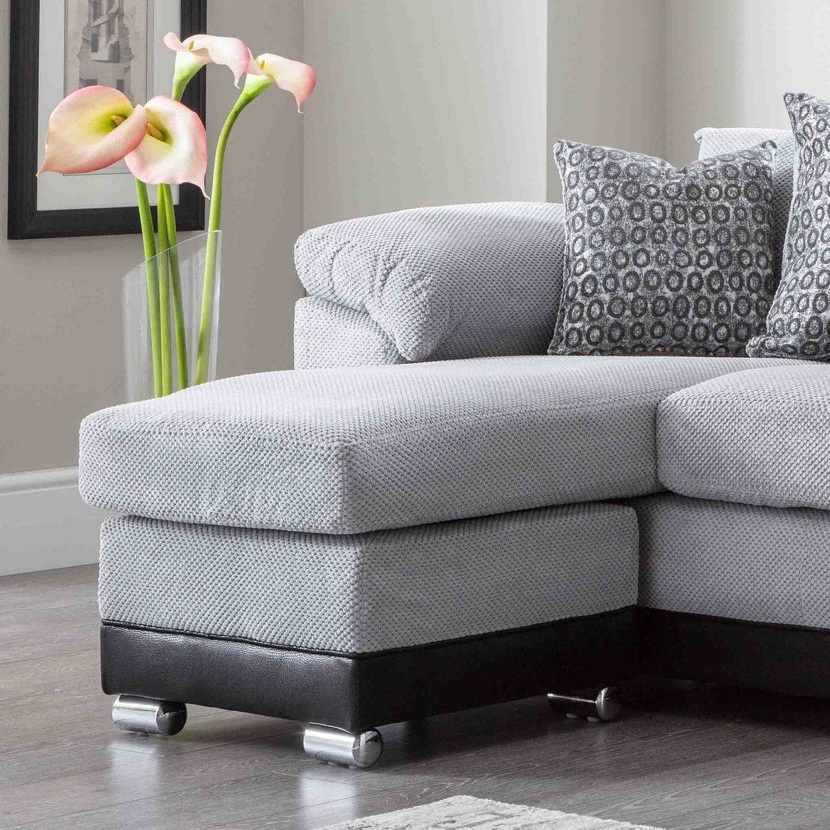 close up of the chaise cushion and footstool on the Ameba Silver Fabric & Faux Leather Corner Chaise Sofa