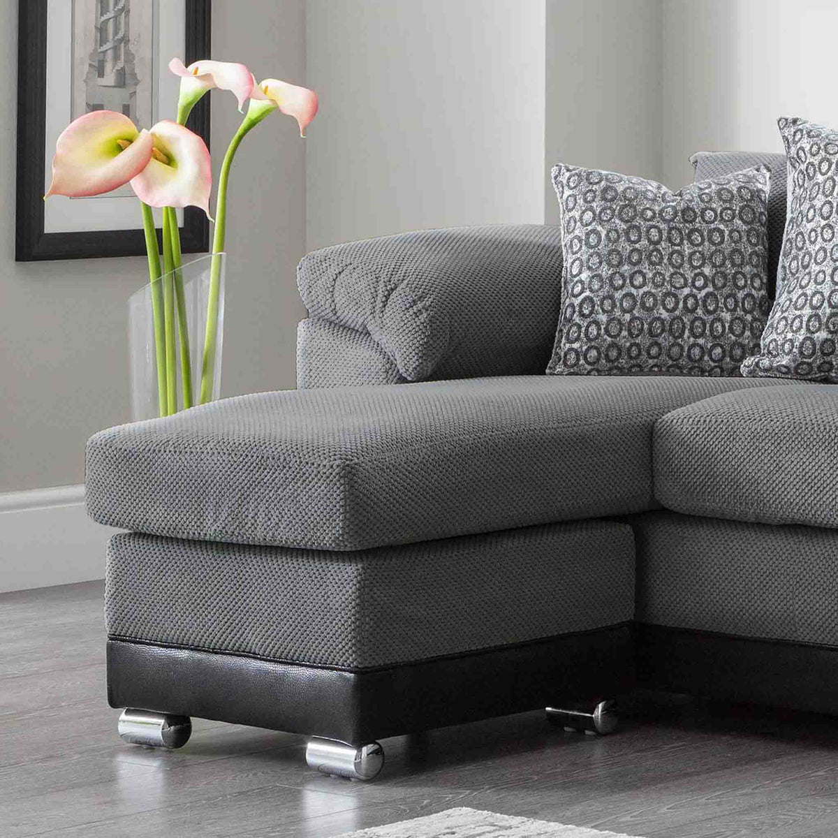 close up of the chaise cushion and foot stool on the Ameba Charcoal Fabric & Faux Leather Corner Chaise Sofa