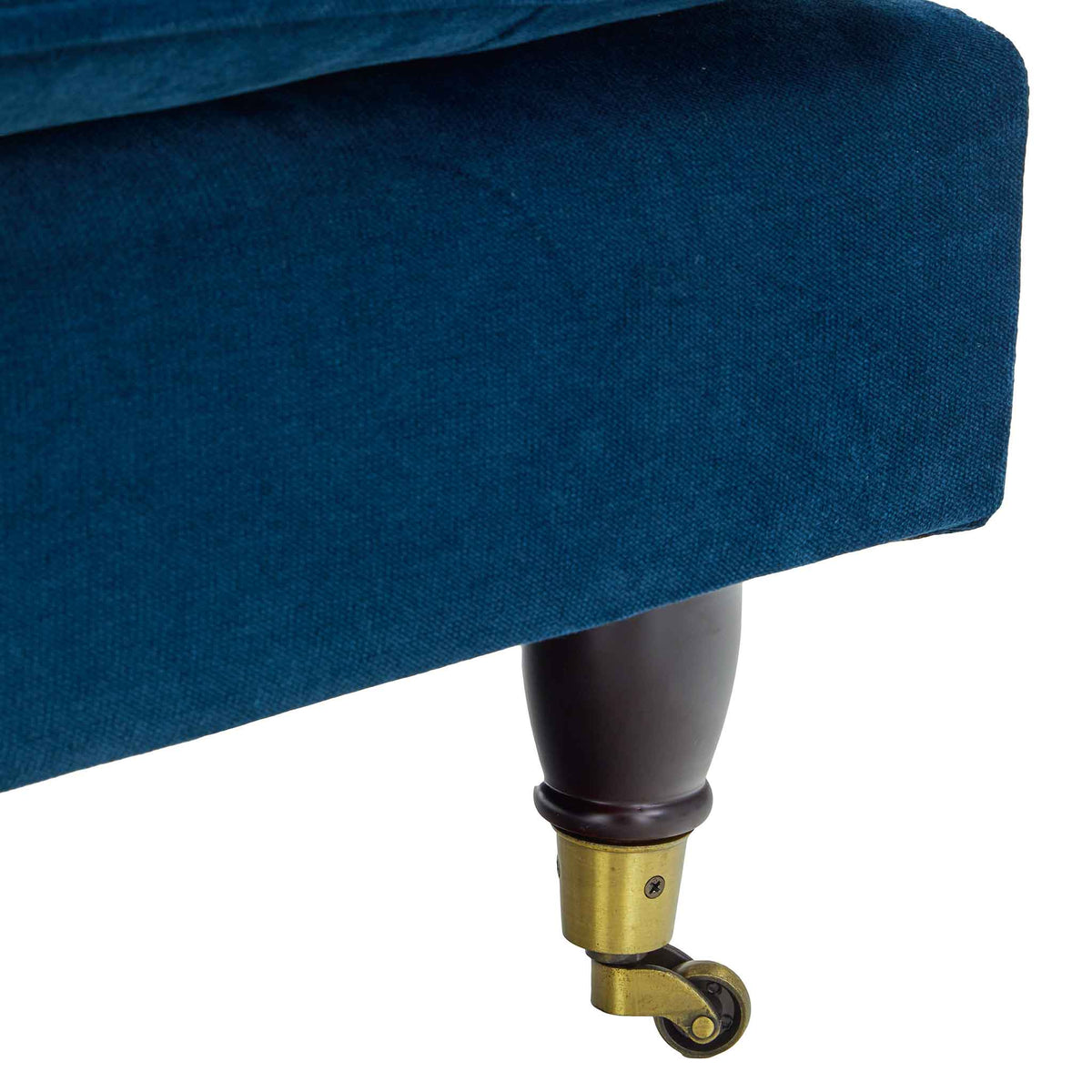close up of the turned legs on the Piper Peacock Velvet Corner Chaise Sofa from Roseland Furniture