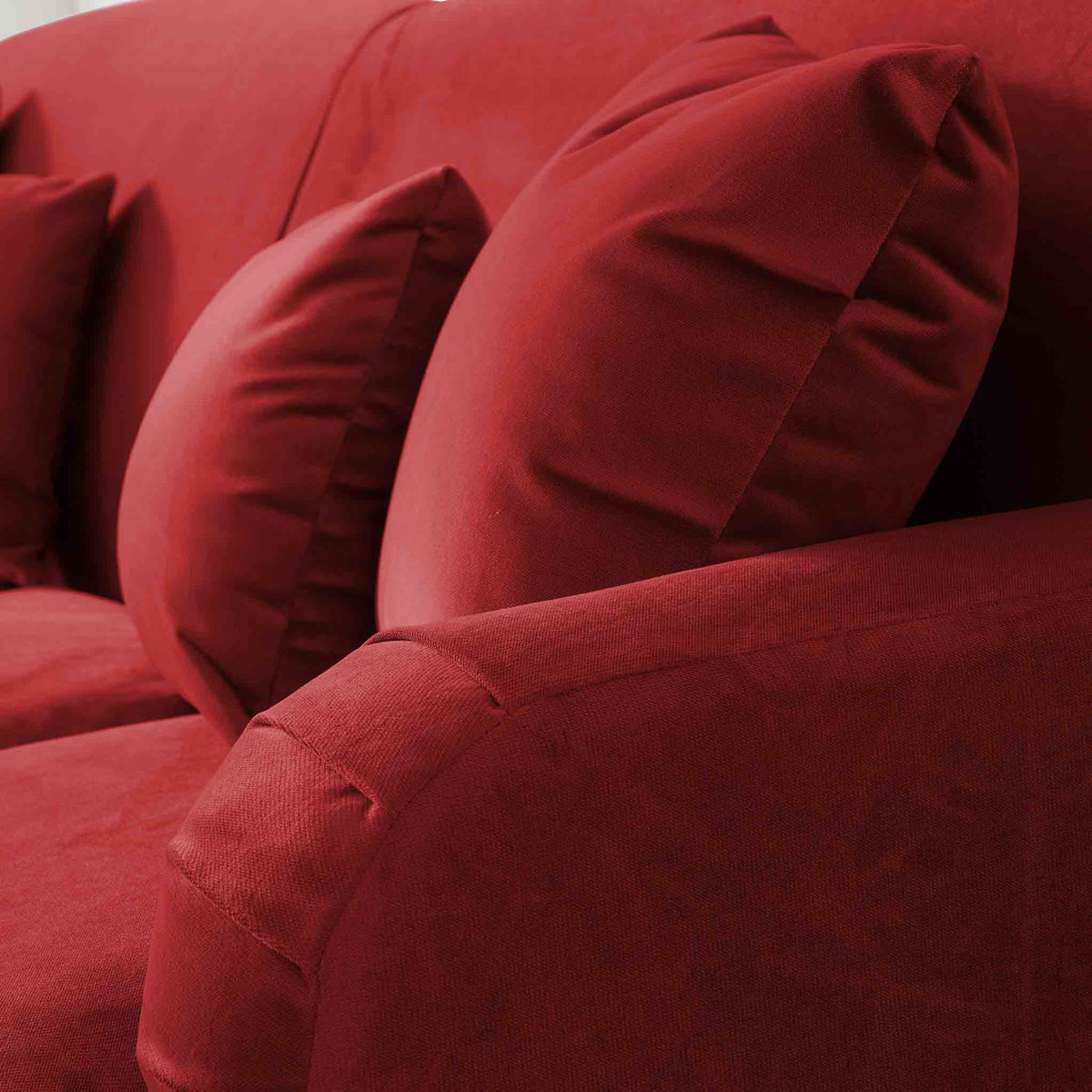 close up of English roll arms on the Piper Apricot Velvet 2 Seater Sofa