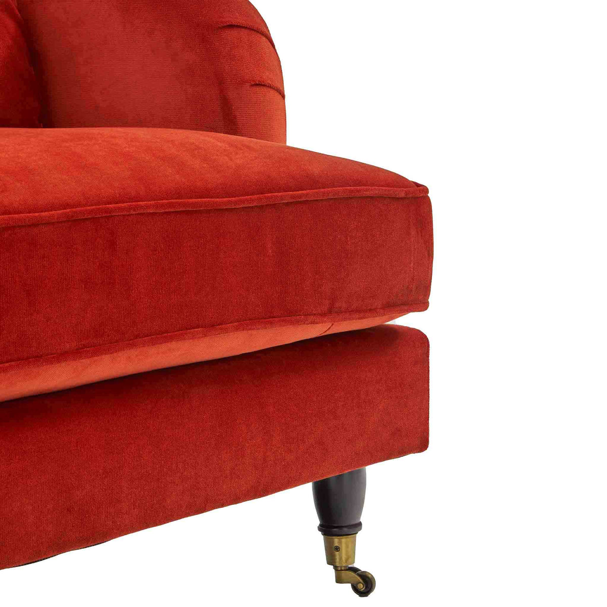 close up of the turned legs on the Piper Apricot Velvet Corner Chaise Sofa from Roseland Furniture