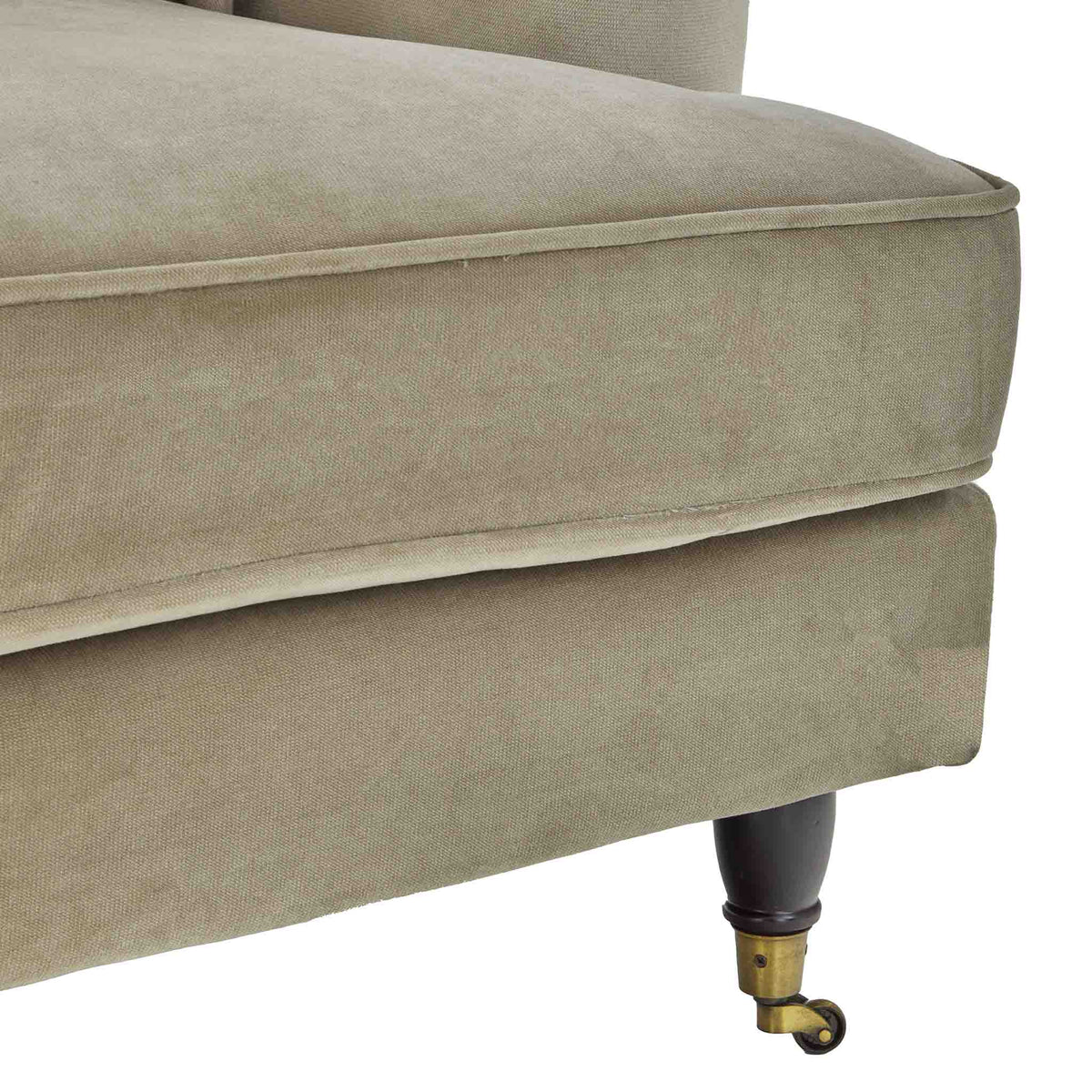 close up of the turned legs on the Piper Putty Velvet 2 Seater Sofa from Roseland Furniture