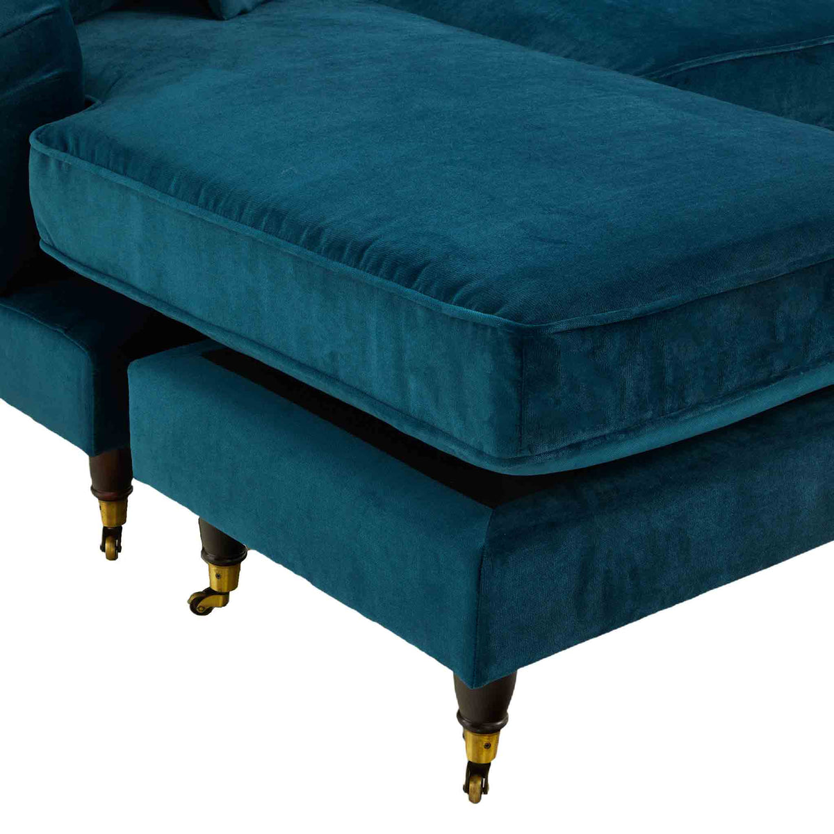 close up of the stool and chaise cushion on the Piper Peacock Velvet Corner Chaise Sofa from Roseland Furniture