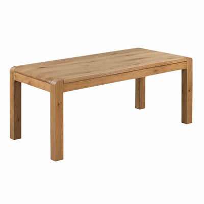 The Capri Oak Chunky Rustic Wooden Dining Table from Roseland Furniture