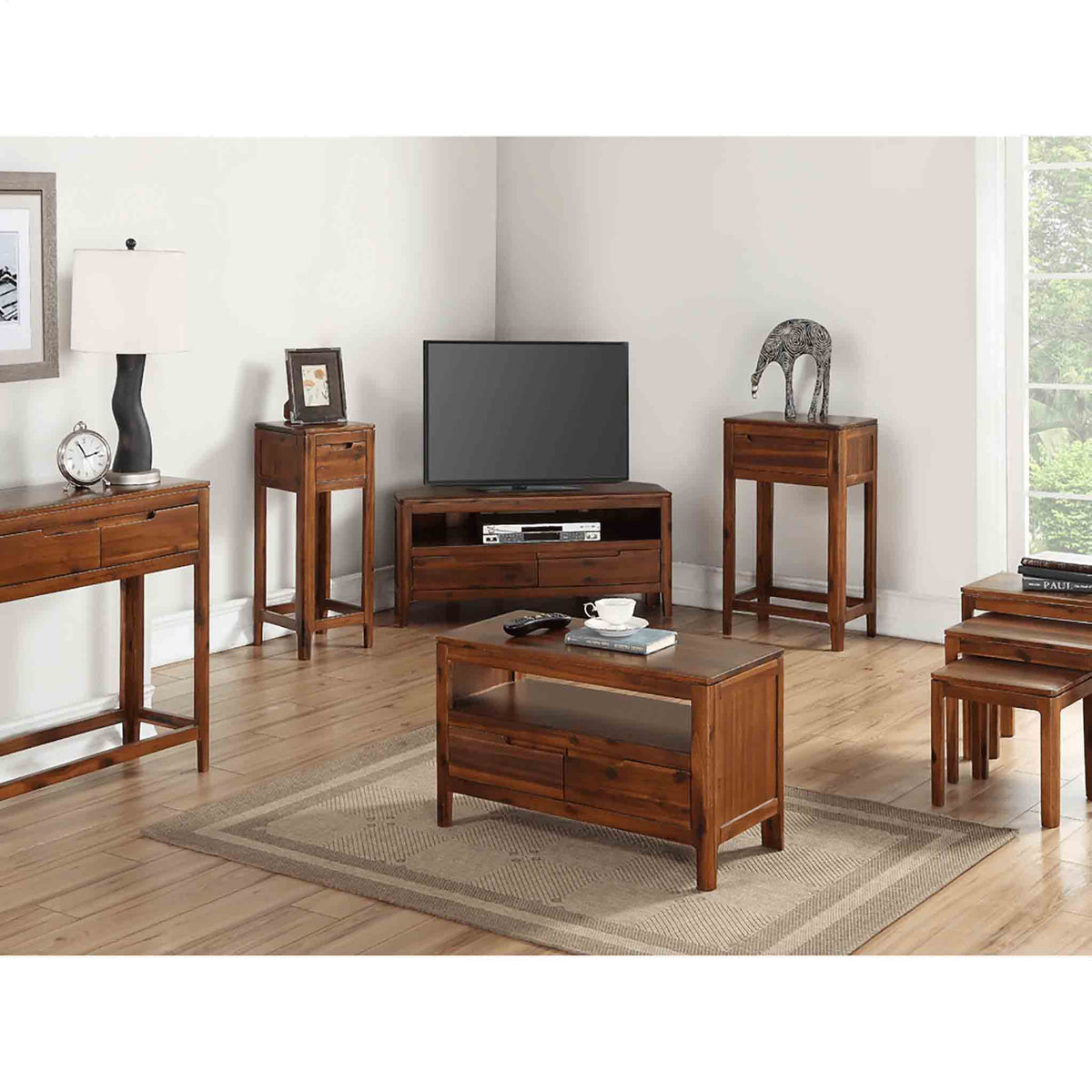 Lifesytle image with The Dunmore Acacia Dark Wood Nesting Tables from Roseland Furniture
