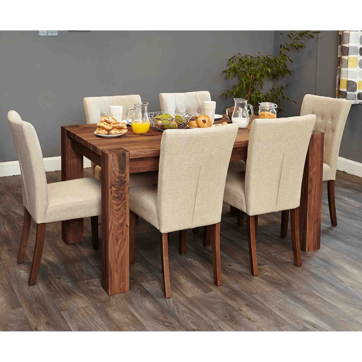 The Salem Walnut Solid Hardwood Dining Table from Roseland Furniture