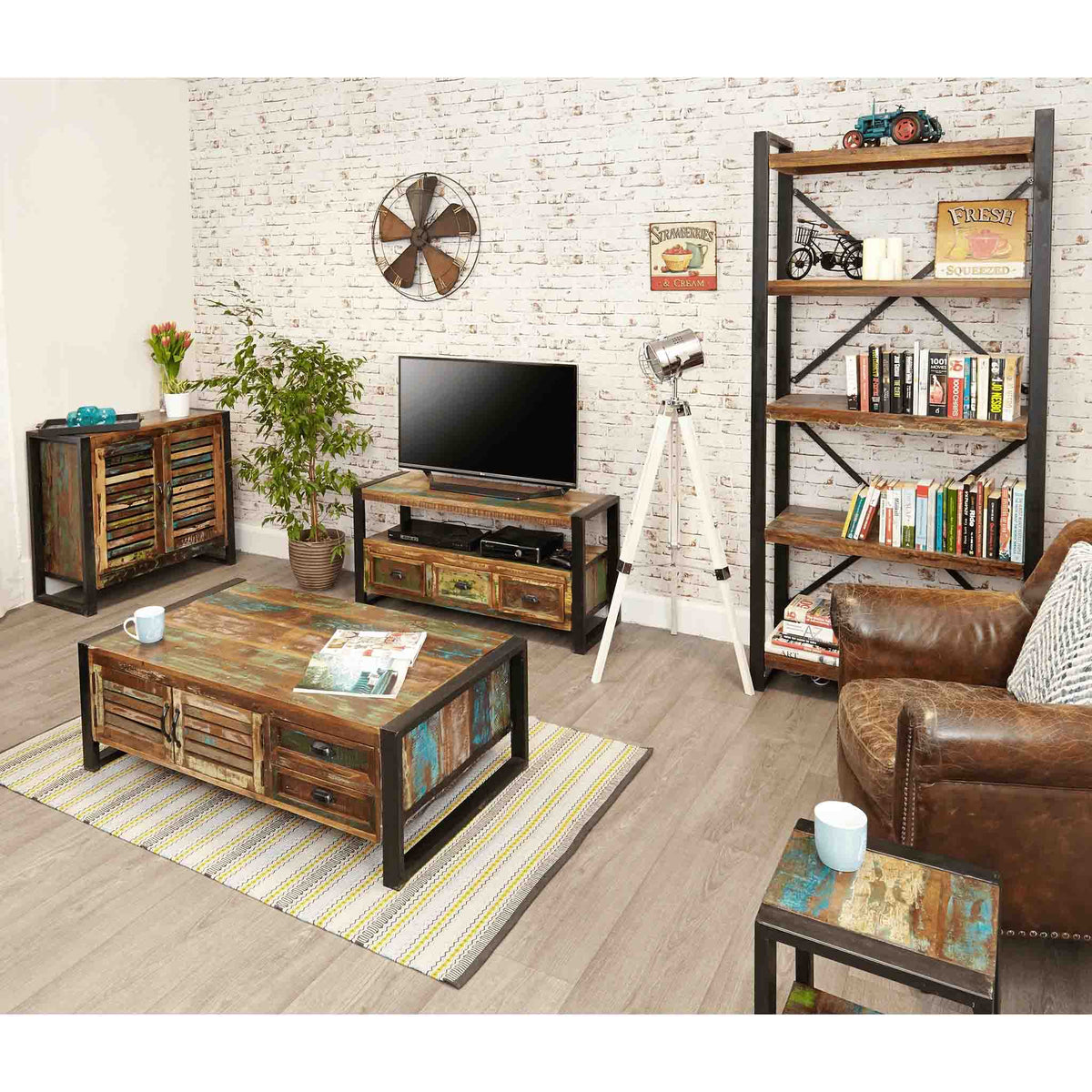 Lifestyle image of The Urban Chic Industrial Reclaimed Wood Large Coffee Table with Storage from Roseland Furniture