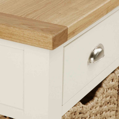 Close up of tabletop corner of The Daymer Cream Painted Oak Console Table