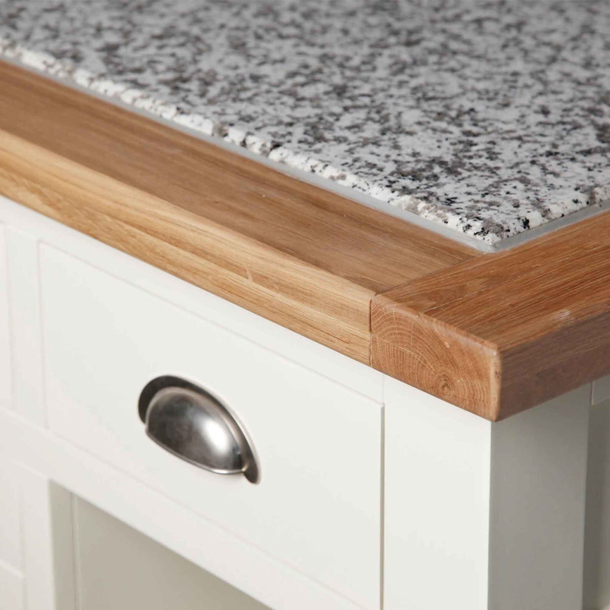 Corner of oak top on The Daymer Cream Oak Top Kitchen Island Breakfast Bar
