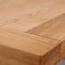 Close up of oak tabletop on The Daymer Cream Wooden Kitchen Cross Dining Table