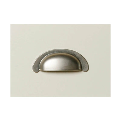Close up of metal drawer handle on The Daymer Cream Painted 3 Drawer Oak Bedside Table