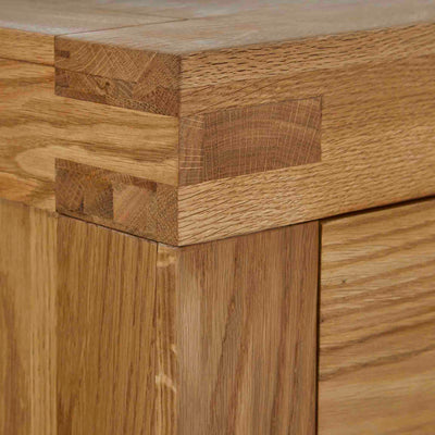 Abbey Grande Large Oak 3 Over 4 Chest of Drawers - Close up of tenon joint on top corner of chest of drawers