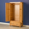 Inside view of the Abbey Light Oak Double 2 Door Wardrobe by Roseland Furniture
