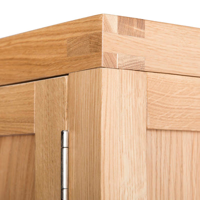 Top corner view of The Abbey Light Oak Double Wardrobe by Roseland Furniture
