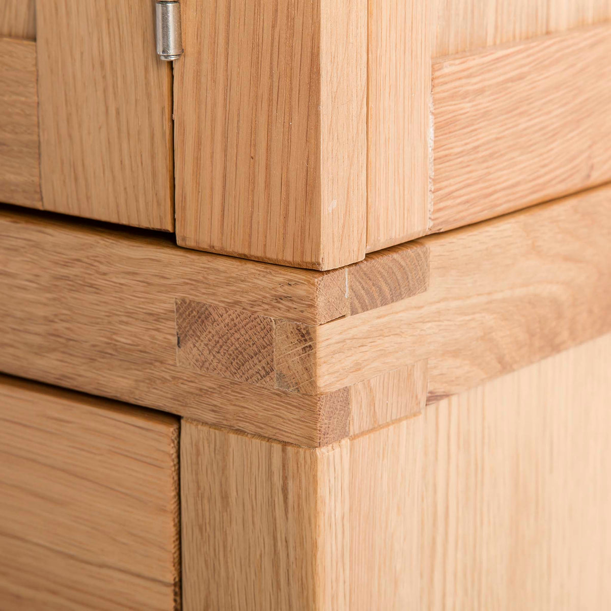 Abbey Light Oak 3 Door Triple Wardrobe with Drawers - Close up of bottom drawer section tenon joint