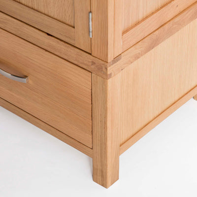 Abbey Light Oak 3 Door Triple Wardrobe with Drawers - Close up of base of triple wardrobe