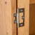 Abbey Light Oak 3 Door Triple Wardrobe with Drawers - Close up of wardrobe door bracket