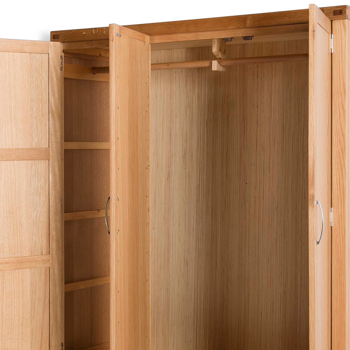 Abbey Light Oak 3 Door Triple Wardrobe with Drawers - Close up of inside wardrobe  and hanging rail