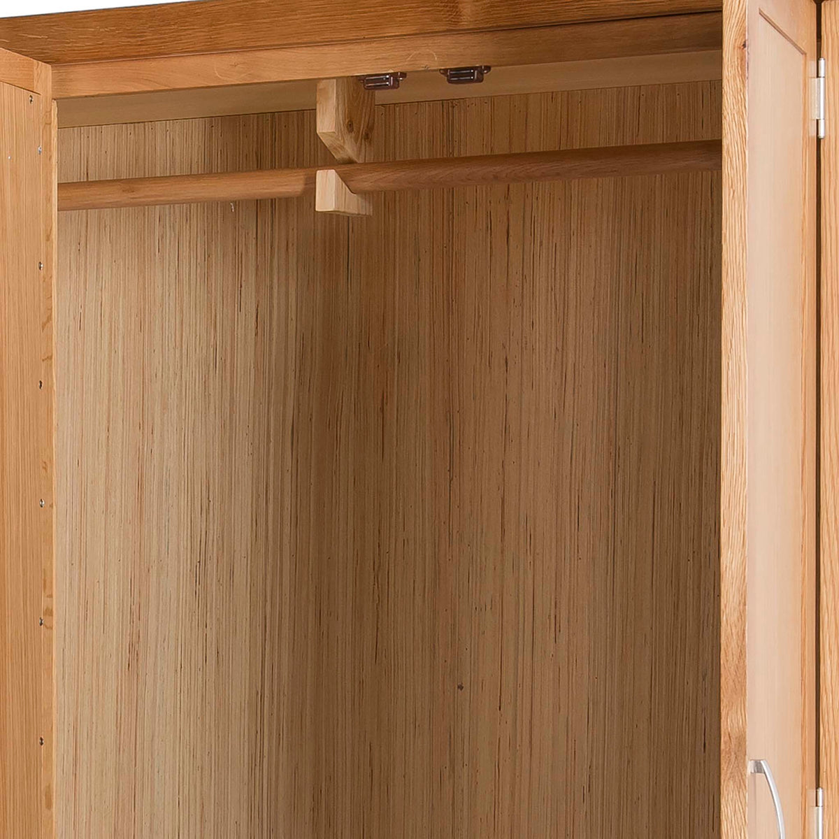 Abbey Light Oak 3 Door Triple Wardrobe with Drawers - Close up of hanging rail