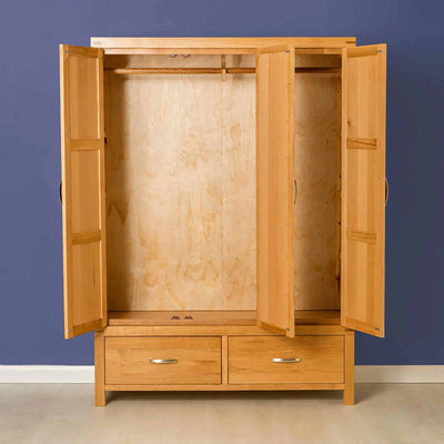 The Abbey Light Oak 3 Door Triple Wardrobe with drawers - Lifestyle with doors open