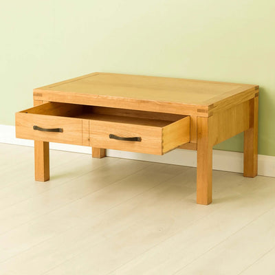 The Abbey Waxed Oak Coffee Table with Storage - Lifestyle with drawer open