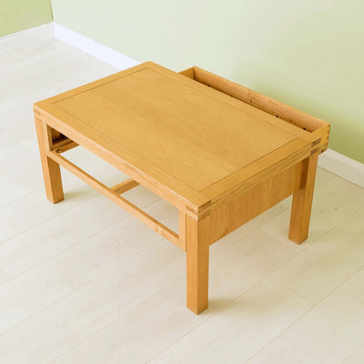 The Abbey Waxed Oak Coffee Table with Storage - Lifestyle with drawer open other side of table