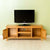 Opened cupboard doors on The Abbey Waxed 120cm Large Oak TV Stand Storage Unit