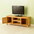 Opened cupboard doors on The Abbey Waxed 120cm Large Oak Television Unit