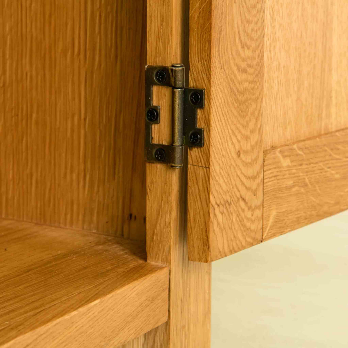 Close up of hinge on The Abbey Waxed 120cm Large Oak TV Stand Storage Unit