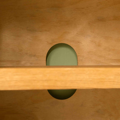 Cable hole on The Abbey Waxed 90cm Small Oak TV Stand Storage Unit